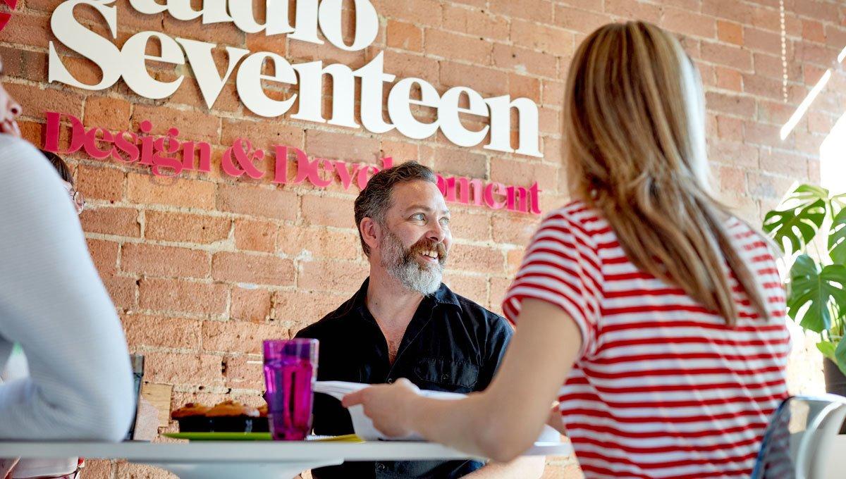 Studio Seventeen Gareth Roberts (man in front of studio seventeen wall)