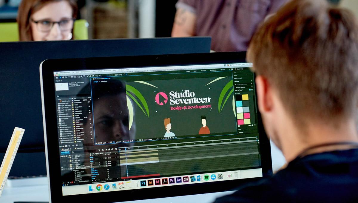 web launch Studio Seventeen (man reflected in computer screen)